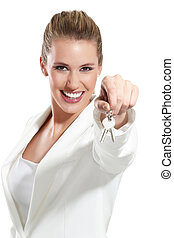 business woman with keys of an apartment on white