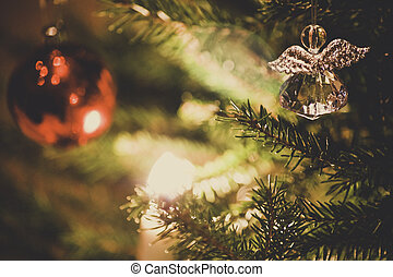 Angel ornament hanging on a tree