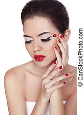 Eyeliner. Beauty girl. Eye Makeup. Manicure and Red Lips. Fashion Make-up and Manicure. Isolated on white background