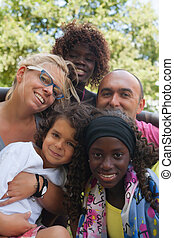 Ethnic Family - Happy multicultural family having a nice...