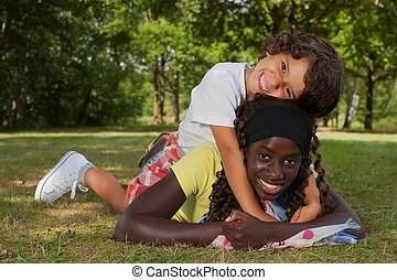 Riding my adoption sister - Happy african children having a...