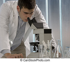 Scientist using a microscope, chemistry related or medical...