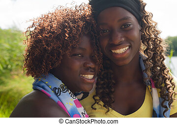 Portrait of 2 black sisters - Happy african children having...