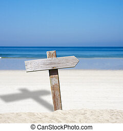 wooden sign on the beach