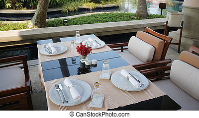 Table setting - Elegant table setting for two - fine dining.