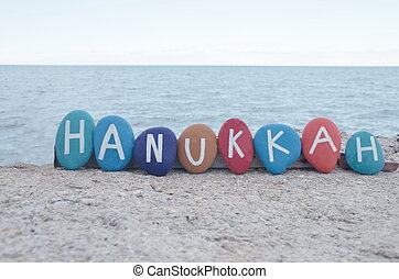 Happy Hanukkah on colourful stones - Hebrew Festival of...