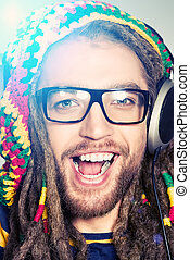 cheerful emotion - Portrait of a happy rastafarian young man...