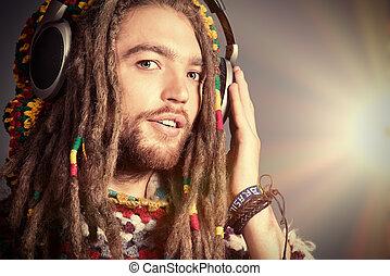 joy music - Portrait of a happy rastafarian young man...
