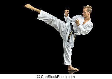 Karate - Young man in white kimono training karate. Isolated...