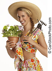 young woman gardener on white background