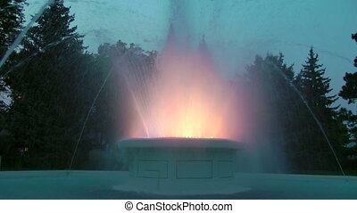 Colorful Fountain at Dusk - Dancing water and lights of a...