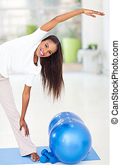 african american woman stretching before exercising