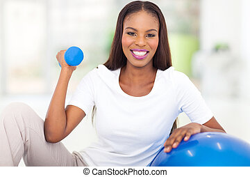 african american woman doing fitness exercise - happy...