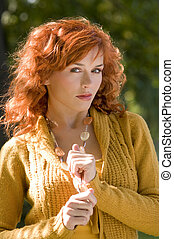 shining - beautiful portrait of a young and red haired woman...