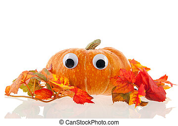 Funny pumpkin with eyes and leaves