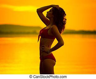 Portrait of brunette woman posing in profile
