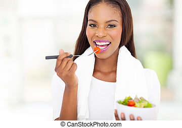 african american woman eating salad - pretty african...