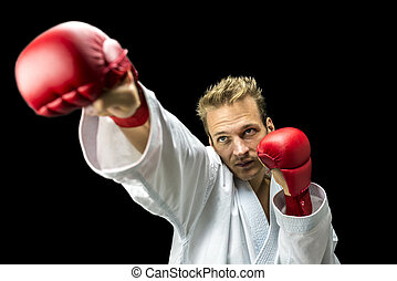 Kickboxer fighter performing a martial arts punch -...