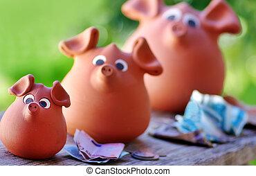 Three ceramic piggy banks
