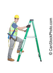 Construction Working Climbing Ladder - A construction worker...