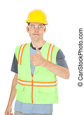 Construction worker gives thumbs up sign - A construction...