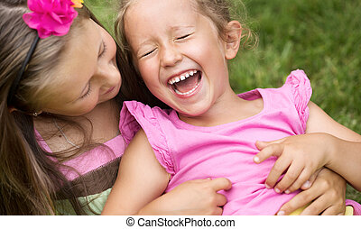 Cute girl tickling her younger sister - Cute girl tickling...
