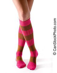 Young woman crossed legs posing with pink striped socks...