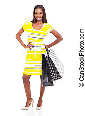 african american fashion model posing with shopping bags -...