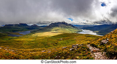 Panoramic view of beautiful lakes and clouds in Inverpolly...