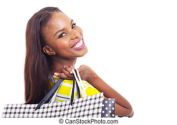 young african american model holding shopping bags - close...
