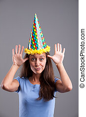 Funny faces and pointy hat - Party clown hat girl showing...