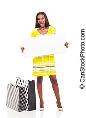 afro american woman holding blank billboard - excited afro...