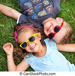 Picture presenting kids relaxing on the grass - Picture...