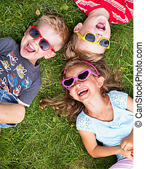 Laughing kids relaxing during summer day - Laughing children...
