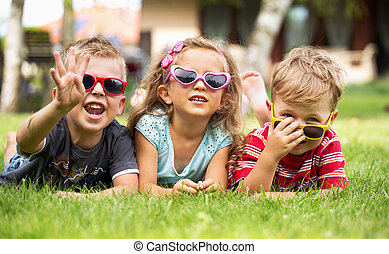 Three cheerful kids playing together - Three cheerful...