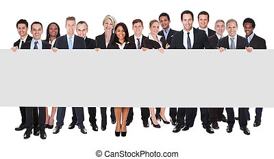 Group Of Businesspeople With Placard - Happy Group Of...