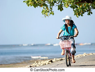 Happy attractive litte girl riding bike outdoor - Portrait...