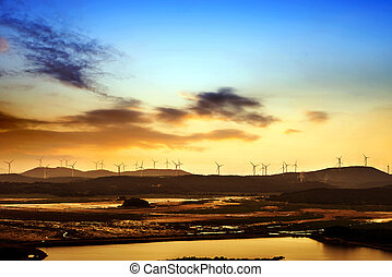 Wind Power - Silhouette of wind power station on sunset