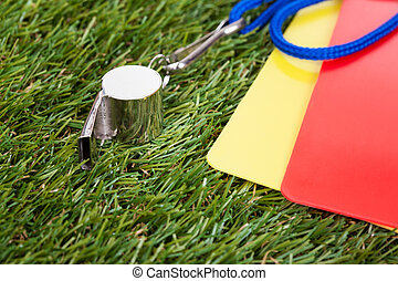 Whistle With Red And Yellow Card On The Field - Close-up Of...