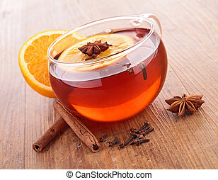 cup of red tea and orange