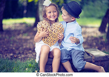Portrait of cute couple of small children - Portrait of cute...