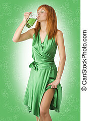 drink green beer - pretty redhaired girl wearing green dress...