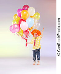 Small boy holding bunch of balloons - Small kid holding...