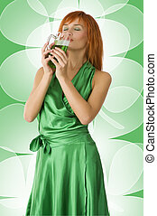 greeen beer - graceful red head girl in act to drink green...