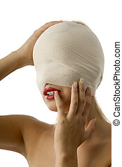 holding head - portrait of woman with bandage around face...