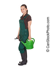 Happy Woman Holding gardening tools - Happy Woman Holding...