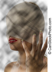 mummy in pain - portrait of woman with bandage around face...