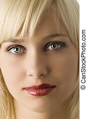 close up of blond girl with rich purple make up color