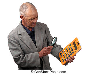 Number crunching - A senior person uses a magnifying glass...