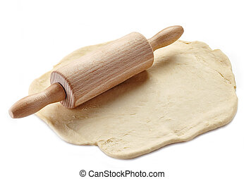 Wooden rolling pin and dough on a white background